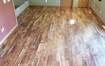 Acacia wood floors changed the feel of this lower level